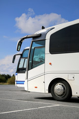 Two White Coach Buses and Summer Sky