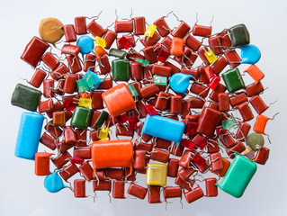 Background pile of old capacitors with led bulbs, use colorful.