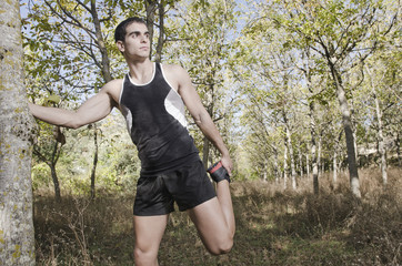 runner man warming in the forest