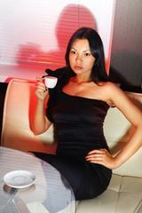 brunette drinks coffee