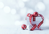Fototapety White Christmas gift with red ribbon