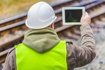 Railway engineer filmed rails with tablet PC