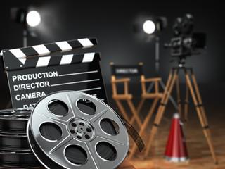 Video, movie, cinema concept. Retro camera, reels, clapperboard