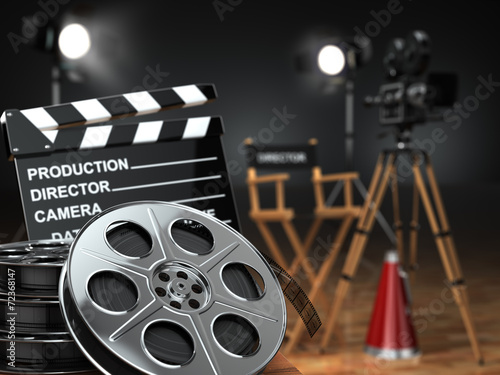 canvas print picture Video, movie, cinema concept. Retro camera, reels, clapperboard