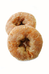 Two Spicy Glazed Pumpkin Donuts on White