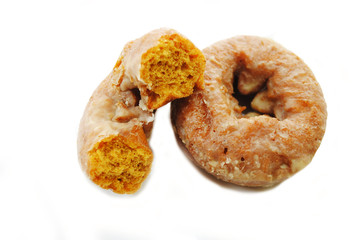 Half of a Pumpkin Donut Leaning on a Whole Donut