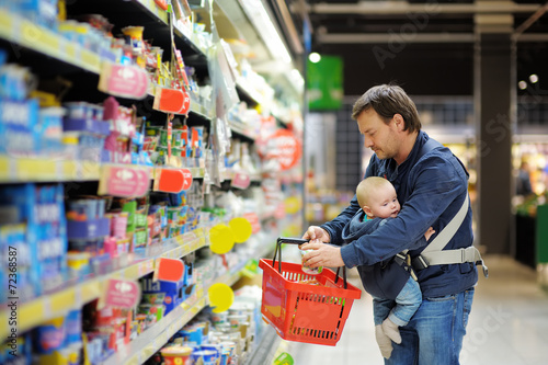 Father and his son at supermarket - 72368587