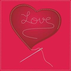 Love bordado sobre corazón