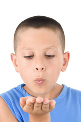 Adorable child sending a kiss a over white background