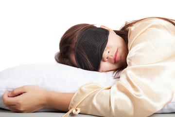 Sleeping Asian girl with eye mask