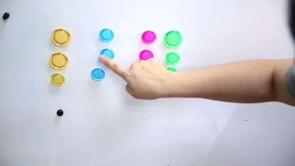hand categorise colourful magnet on magnetic board