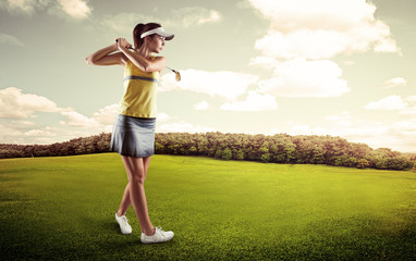 Active female player preparing for hitting golf ball.