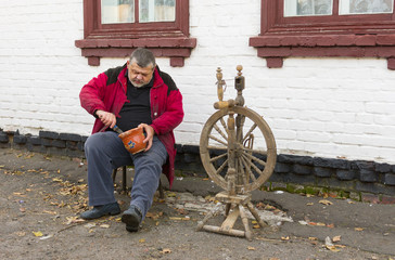 Ukrainian country man doing daily work at the homestead