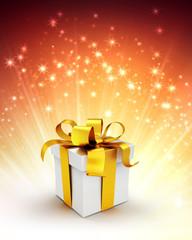 gift box on shiny gold background