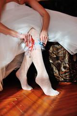 White garter on the leg of the bride