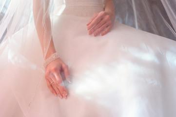 bride hands under the veil