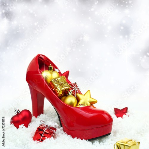 canvas print picture High heel shoe with christmas ornaments on snow