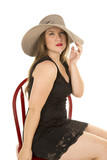 woman red lipstik hat sit hold hat down poster