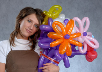 Young girl with a bouquet of balloons in the studio