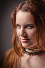 sensual girl with fluffy red hair