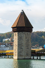 view of wooden Chapel bridge and old town of Lucerne