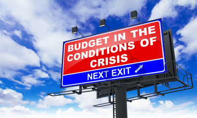 Budget in the Conditions of Crisis on Red Billboard.