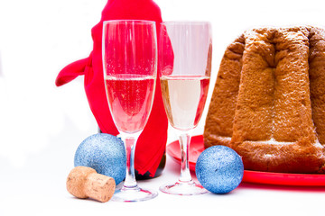 Champagne and Christmas decorations on white background