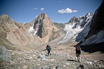 beautiful mountain landscape with two hikers in Fann mountains,