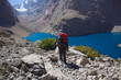 hiker in mountains down to the lake, Fann Mountains, Tajikistan