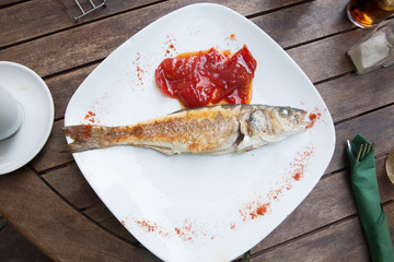 Grilled fish with tomato