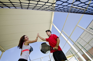 Paddle tennis couple team fair play