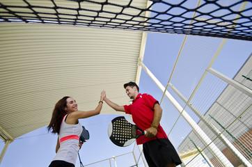 Paddle tennis couple team fair play