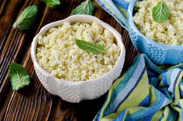 Cous cous with herbs in a ceramic bowl
