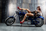 Fototapety Young sexy woman sitting on motorcycle.