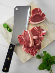lamb chops with meat cleaver and fresh mint