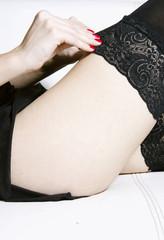 Girl puting on stockings
