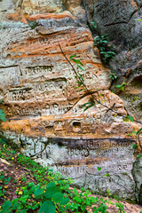 sandstone cliffs with inscriptions