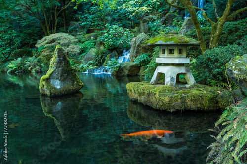 A Lantern and Waterfall in the Portland Japanese Garden - 72382315