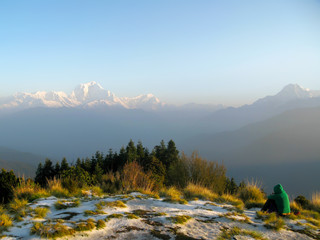 Contemplative Person Watching the Sunrise Over Himalayan Mountai