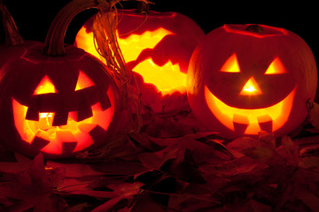 three candle lit Halloween pumpkins
