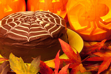 spiders web chocolate cake and pumpkins