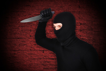 man in mask with knife