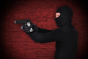 thug with gun and flashlight