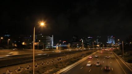 Tel Aviv at night. lightnings sparkle. road traffic