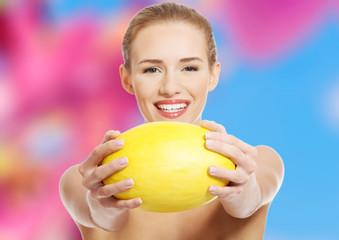 Woman holding a melon