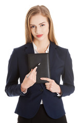 Businesswoman holding a note