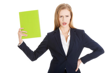 Angry businesswoman holding a note