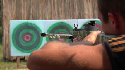man shoots a crossbow at a target, Slow Motion