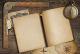 Open blank diary with map, pencil and compass. Adventure and - 72389382