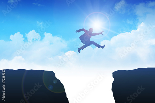 Man jumping over the ravine